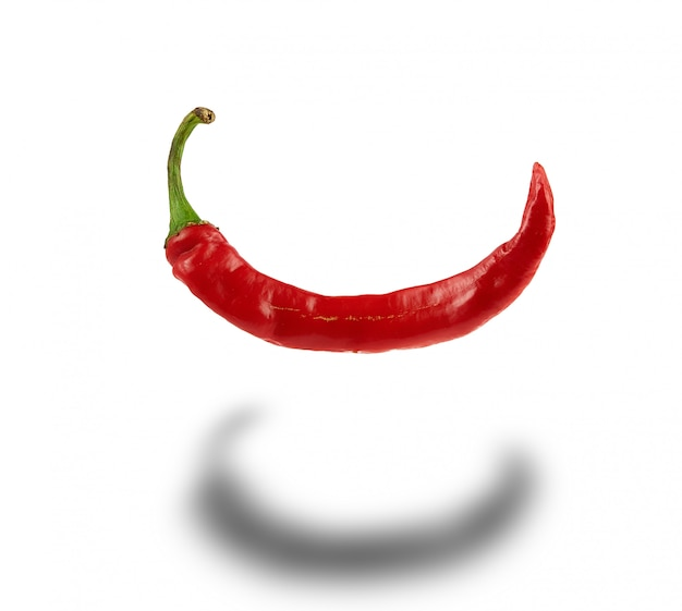 Whole red hot chili pepper isolated on white