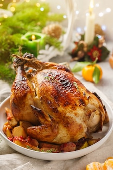 Whole roasted chicken with tangerines and apples
