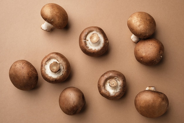 Whole royal brown champignons on brown background