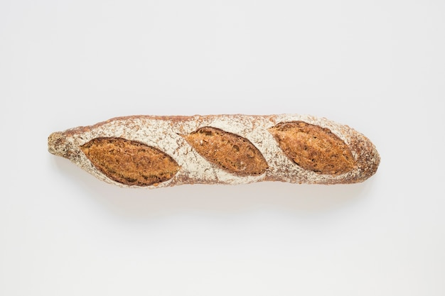 Whole rustic baked baguette on white background