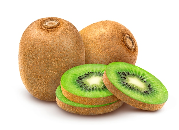 Whole and sliced kiwis on white surface