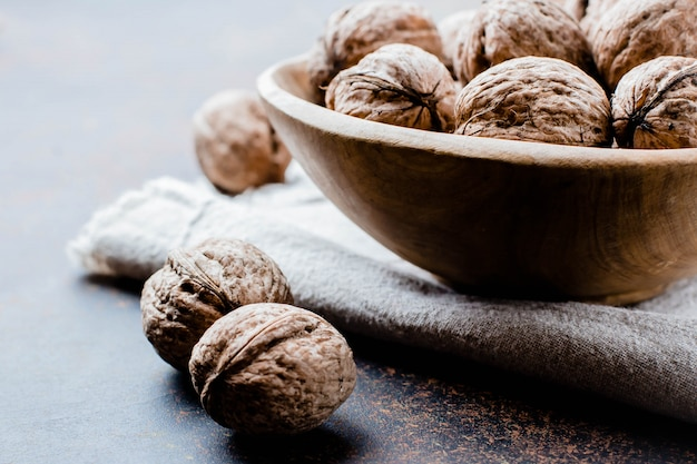 Whole walnuts on dark stone concrete table background. copy space. healhty vegetarian food concept