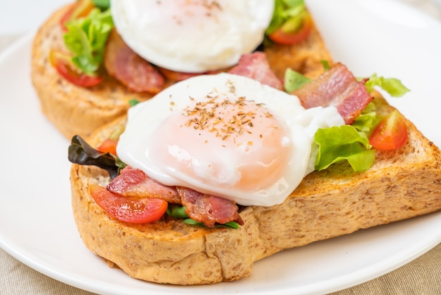 Whole wheat bread toasted with vegetable, bacon and egg