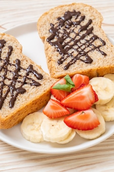 Whole wheat bread with fresh banana, strawberry and chocolate