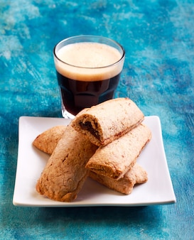 Whole wheat date bars and coffee in glass