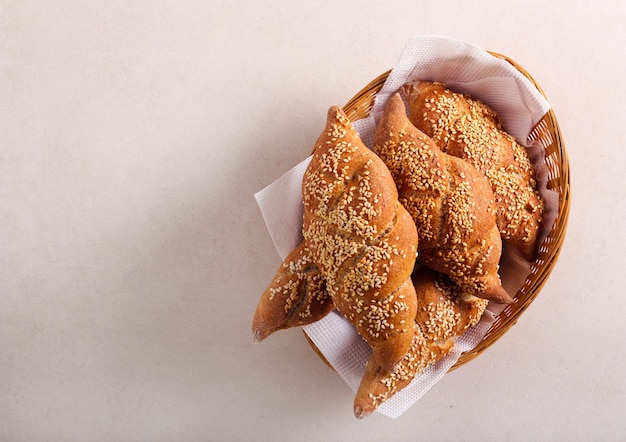 Wholemeal sesame braid buns in a basket
