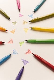 Wi-fi lines drawn with different markers on white paper