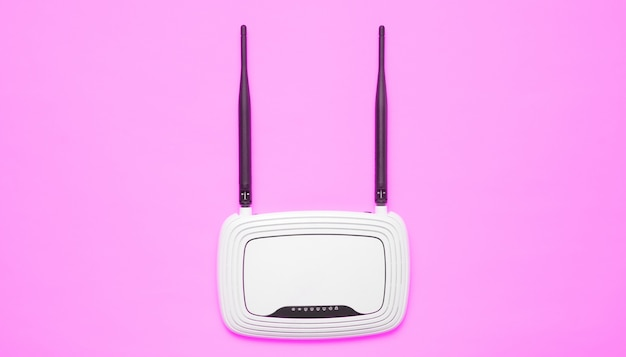 Wi-fi router on pink surface