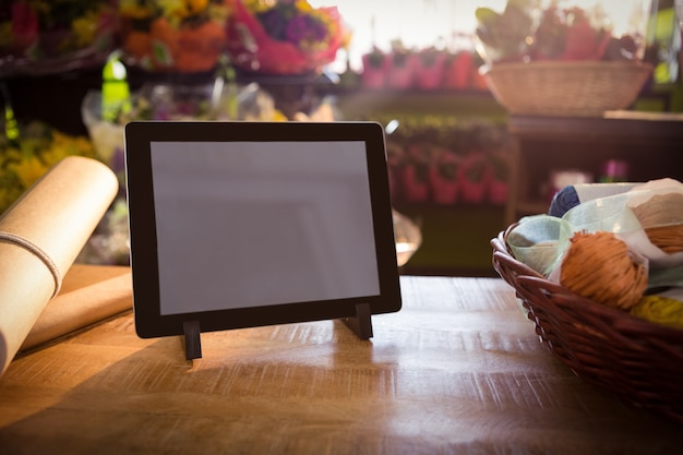 Wicker basket and digital tablet on the wooden table