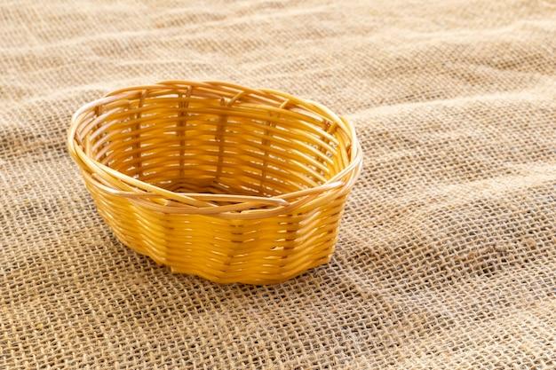 Wicker basket on jute tablecloth