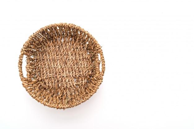 Плетеная корзина на белом фоне