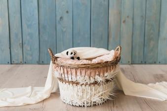 Wicker basket with blankets