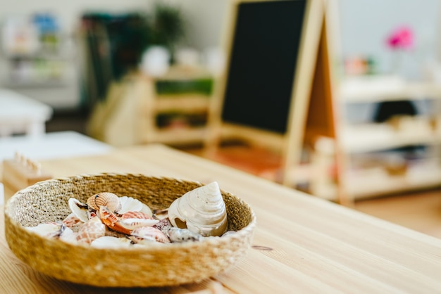 Wicker basket with sea shells in a montessori class