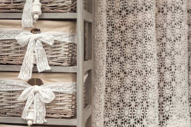 Wicker baskets and crochet curtain