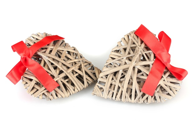 Wicker hearts with red bow isolated on white