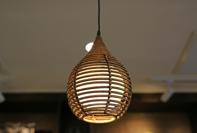 Wicker lamp hanging on ceiling