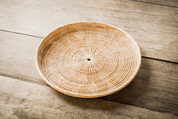 Wicker placemat on wooden table