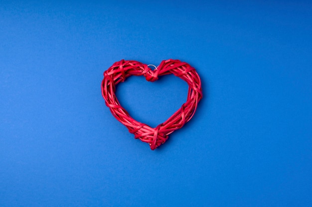 Wicker red heart. copy space, flat lay, top view.