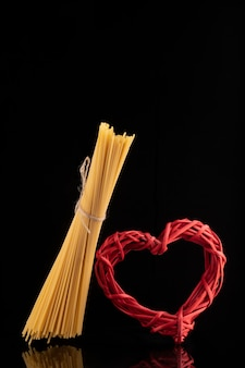 Wicker red heart and flying spaghetti