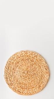Wicker straw stand isolated on white background. upright photo as flat lay, top view minimal social media template