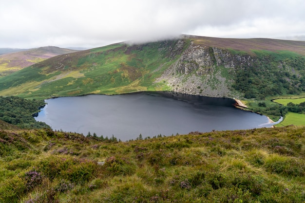 Wicklow way landscape lough tay lake in a cloudy day.