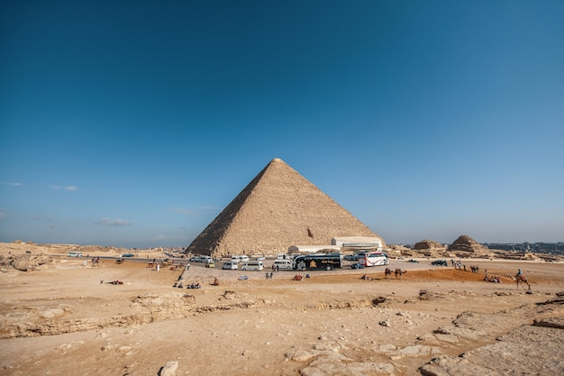 Wide angle shot of an egyptian pyramid under a clear blue sky