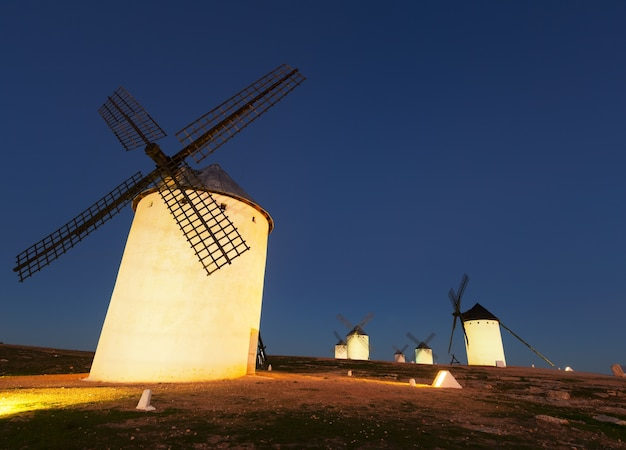 Wide angle shot of group of windmills in night