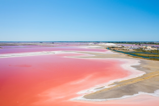 Wide angle shot of the multicolored salt lakes in camarque, france