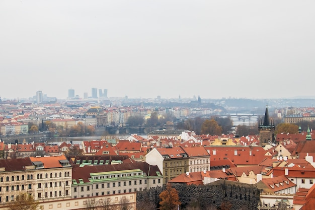 Wide angle view of the buildings of prague under a clouded sky