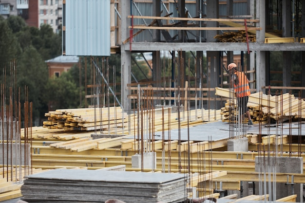 Wide angle view at construction site with metal and concrete structures, copy space