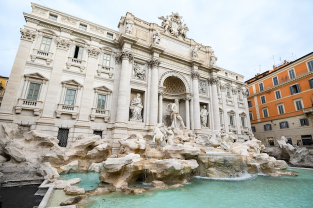 Wide angle view of the famous trevi fountain. a popular tourist spot in the city center.