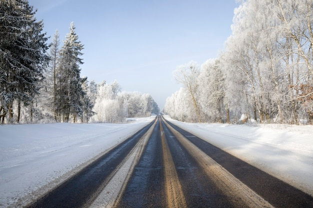 Wide asphalt road in the winter season of the year