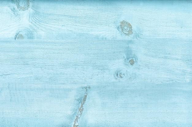 青い色あせたペンキが付いている広い板。ヴィンテージの質感