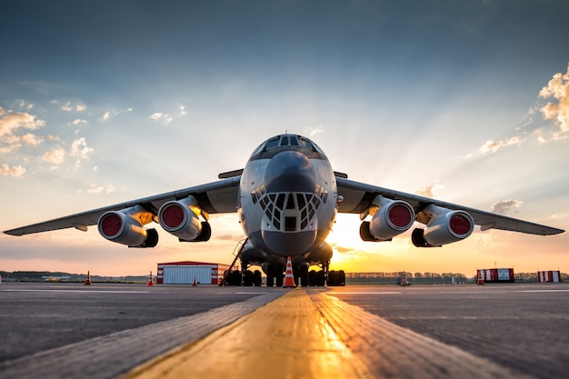 Wide body transport cargo aircraft at airport apron in the morning sun