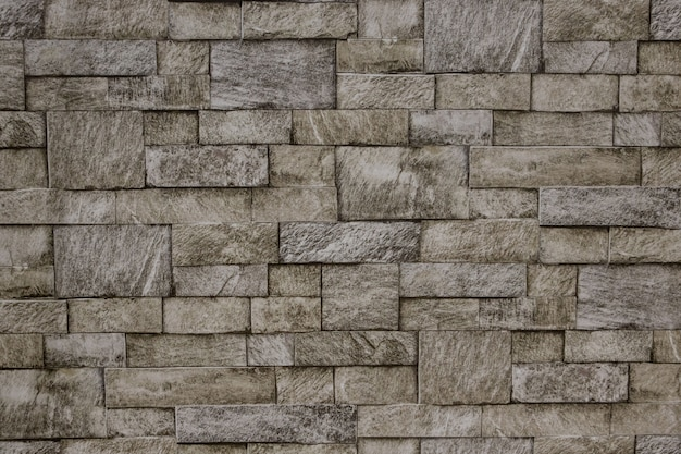 Wide grey brick wall background texture