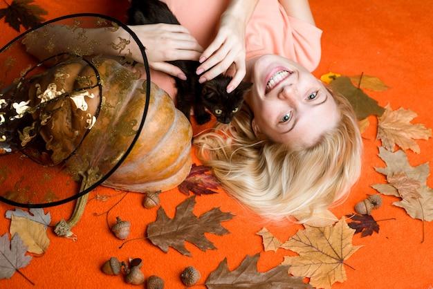 Wide halloween party art design closeup portrait of gorgeous happy blonde fairy enchantress covering...