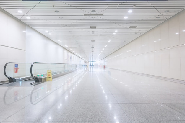 Wide hallway with a moving walkway
