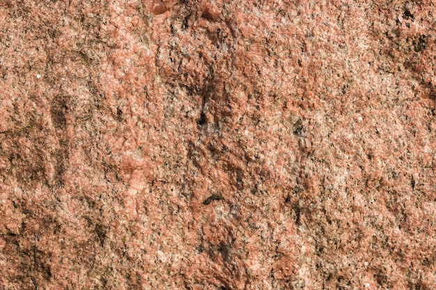 Wide sandy reddish stone texture background for designs