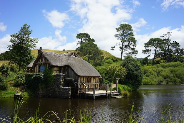 Wide shot of the hobbiton movie set in matamata new zealand