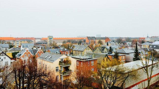 Wide shot of houses and buildings in the city of copenhagen, denmark
