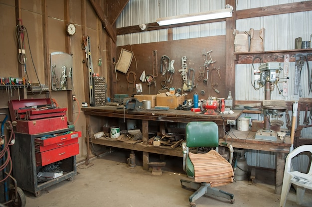Wide shot of an old barn' s workbench with different types of tools