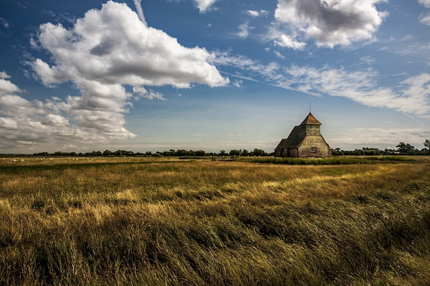 Wide shot of the thomas a becket church at fairfield on romney marsh, kent uk