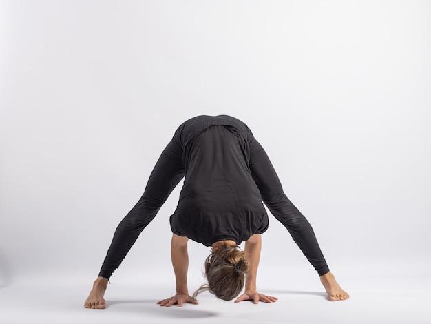 Wide stance forward yoga posture asana
