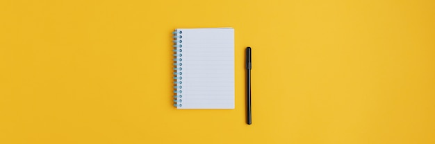 Wide view image of blank spiral note pad and black marker
