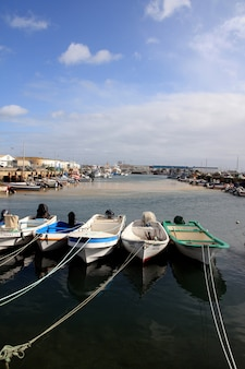 Wide view of the typical fishing docks of portugal.