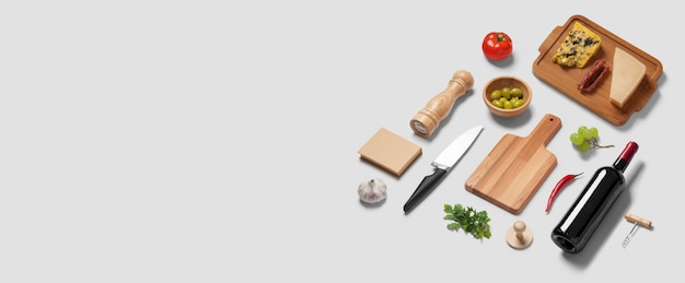 Wide website banner with a top view flatlay scene of kitchen items and italian food cheese wine bottle knife olive tomato
