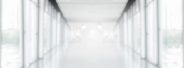 Wide white gray blurred empty abstract corridor pathway background from perspective building hallway