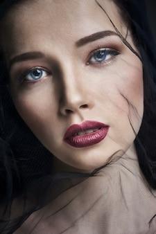 Widow in veils, portrait of young brunette woman