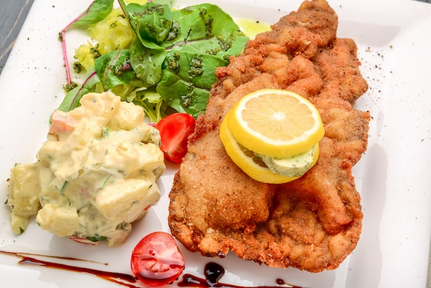 Wiener schnitzel with potato saladnd lemon