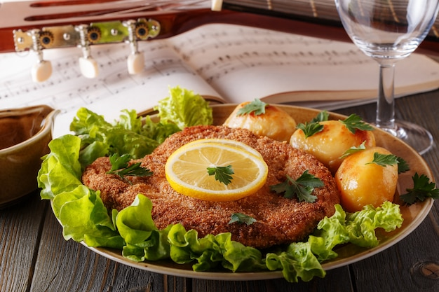Wiener schnitzel with potatoes and salad